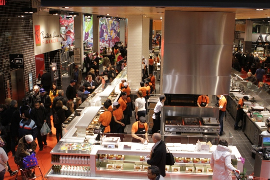 Staff in retro orange uniforms serving the crowds at the new Loblaws.