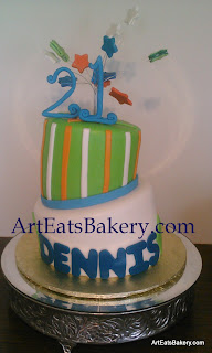 Two tier mad hatter green, blue, orange and white 21st birthday cake with twenty one and stars topper