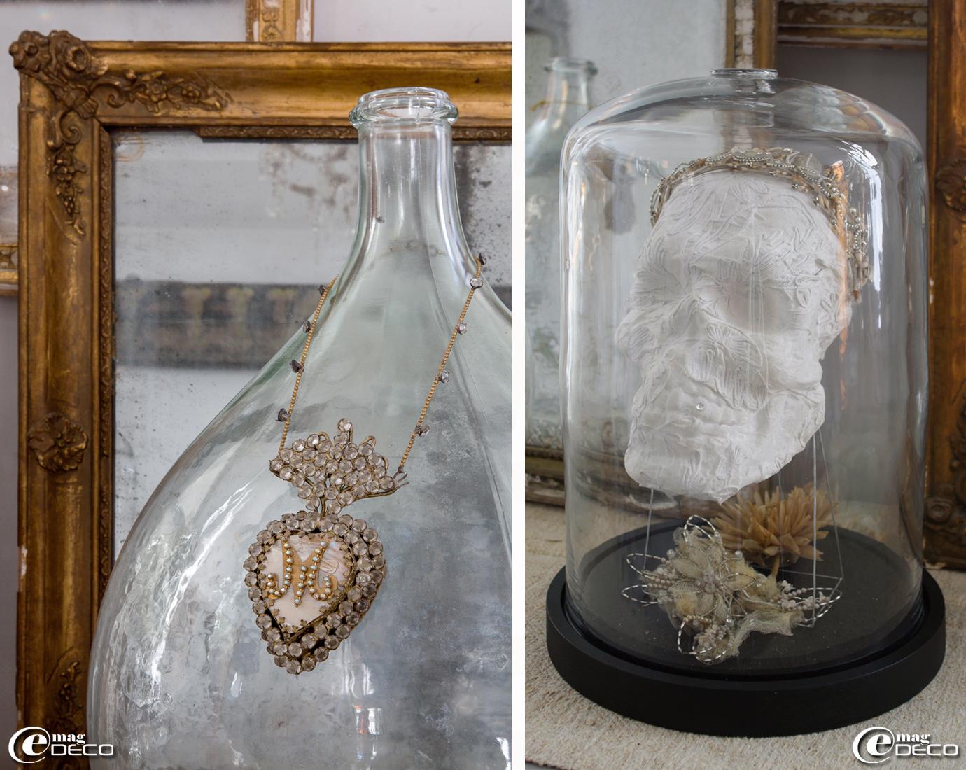 Collier 'ex-voto' accroché à une bonbonne dame-jeanne, crâne sur socle création 'Vox Populi' décoré d'une couronne de mariée et de fleurs en tulle et perles