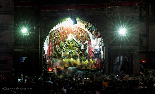 Time lapse photo of Swet Bhairab of people trying to drink the Holy Alcohol