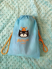 Jellycat ted in a blue bag