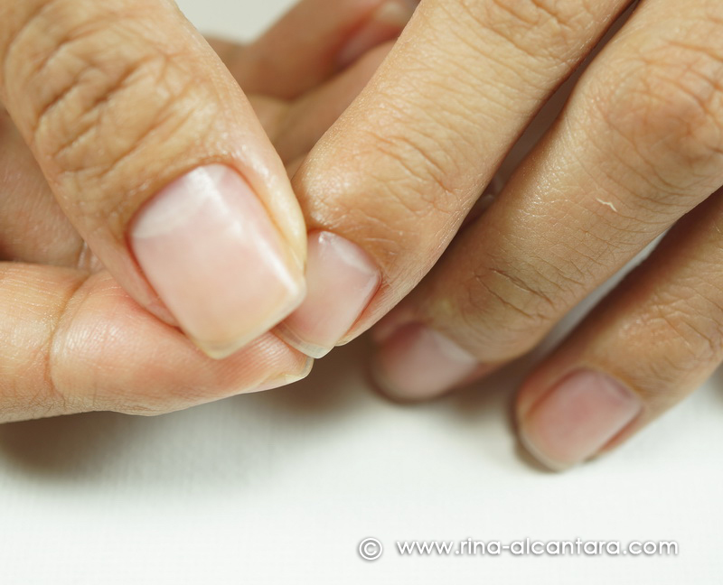 Massaging cuticle oil on the nails