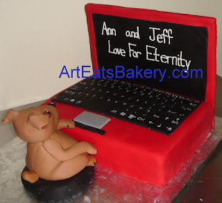 Minture Pincher dog sugar figure typing on a custom red fondant 3D laptop computer Groom's cake