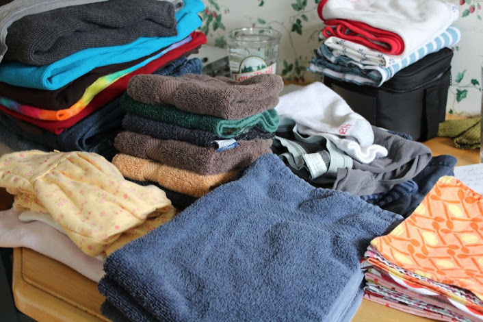 neatly folded stacks of clean clothes and towels