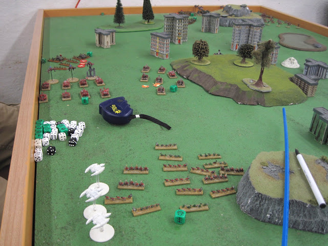 Eric's Orks make a rush towards the center to cut Chris's frontline troops off.