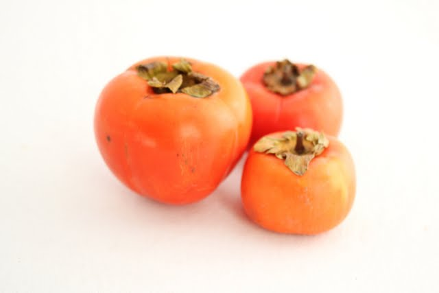 photo of three persimmons