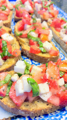 Strawberry Bruschetta, vegetarian and easy to put together with fresh strawberries, basil, olive oil and balsalmic vinegar, and fresh mozzarella cheese on good bread
