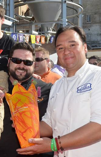 San Antonio chef Johnny Hernandez, founder of the Paella Challenge, presenting award to chef James Canter