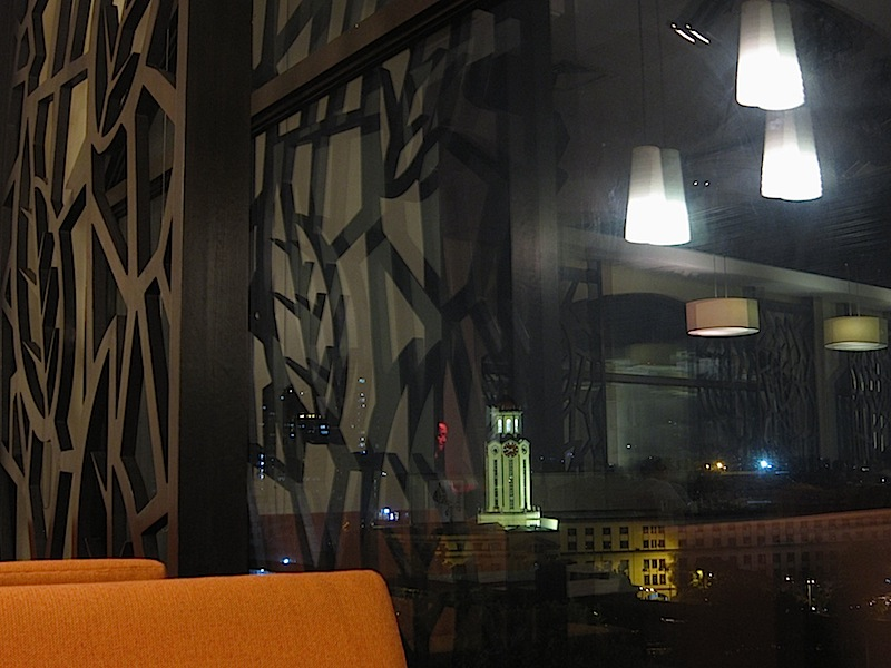 a window of 9 Spoons restaurant at night