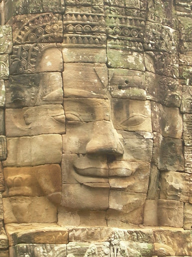 One of the many faces at Angkor Wat. The Definitive Guide to Moving to Southeast Asia: Cambodia
