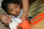 LePort Montessori Preschool Toddler Program Irvine San Marino - life skills, pouring water