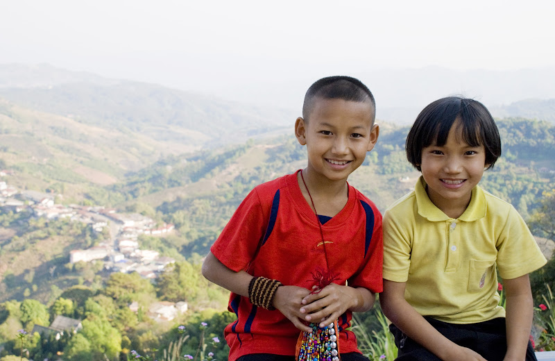 Kids selling jewelry by the temple in Mae Salong