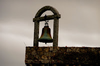 hanging bell in silhouette