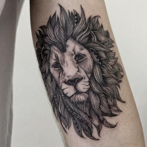 55 brilliant lion tattoos designs and ideas. Black Bedroom Furniture Sets. Home Design Ideas