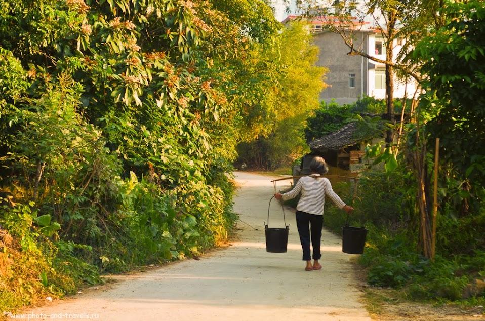 Туры в Китай. Отдых в деревне Яншо. Где-то на белом свете есть места, где воду еще носят на коромысле