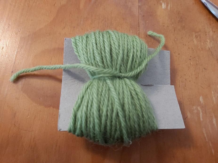 Yarn wound around pompom form