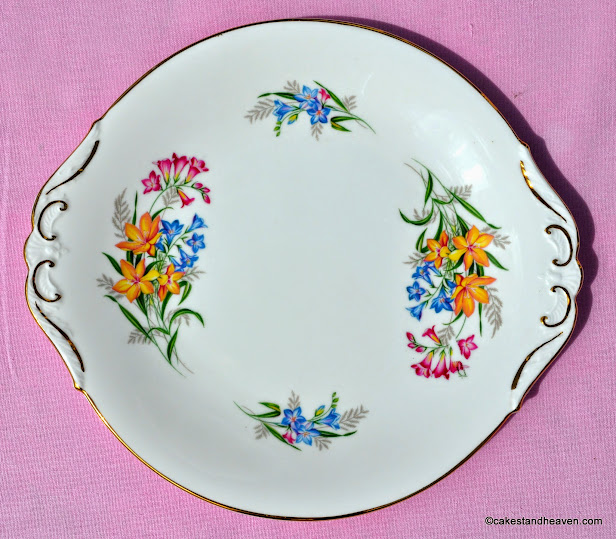 colourful Sheridan vintage cake plate with freesia style flowers