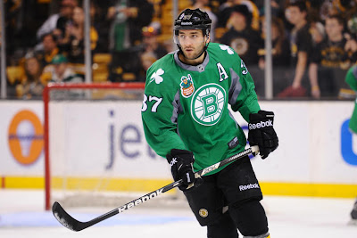 Patrice Bergeron wearing the green St Patrick's warm up jersey during warm ups