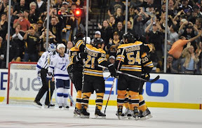 Boston Bruins players celebrate a goal