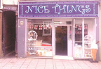 Shopront with giant ice cream outside and happy magical dark blue looking name board