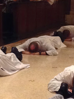 Lying prostrate during the Litany of the Saints