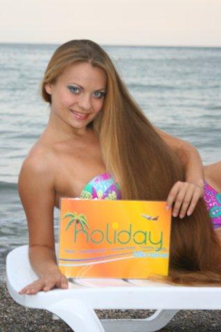 photo of long blonde hair girl at the beach Mermaid Luxury Holiday