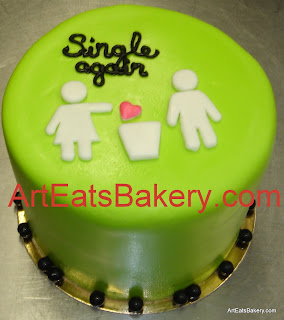 Single again green fondant celebration cake with girl and boy throwing away a heart picture