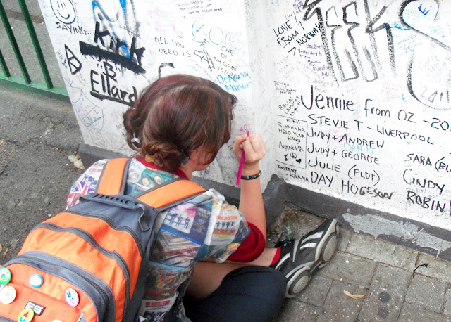 Aubrey leaving a message on the wall