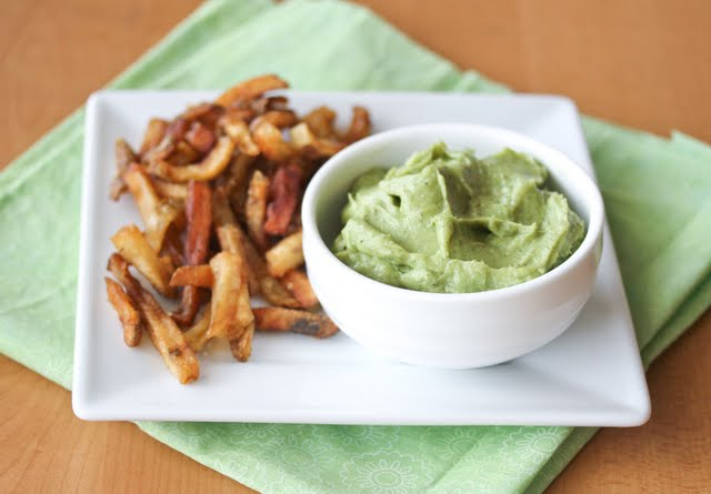photo of french fries on a plate with a bowl of Avocado Ranch Dip
