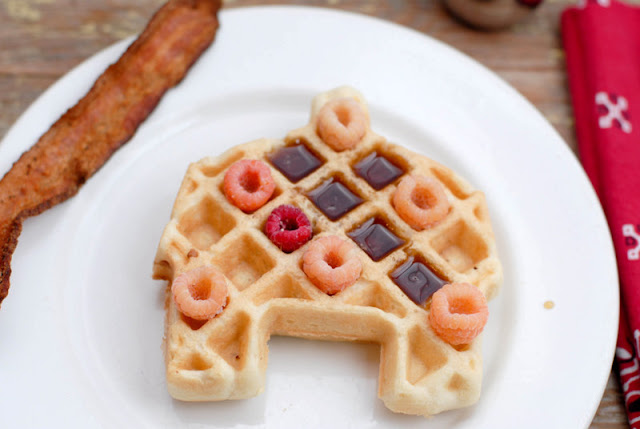 barn shaped waffle with berries and syrup