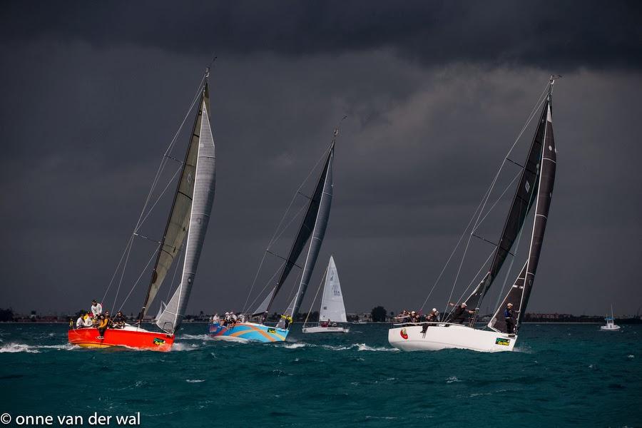 J/111s reaching off Key West under squally skies