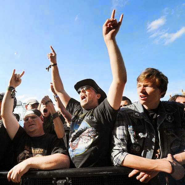 Heavy metal fans attend a concert during the Hellfest Heavy Music Festival on June 20, 2014 in Clisson, western France.