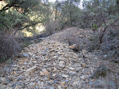 Some of the huge piles of tailings in this part of the canyon ©http://backpackthesierra.com
