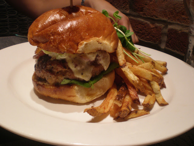 The Three Pigs Burger: bacon, pulled pork, and ground pork in one harmonious patty.