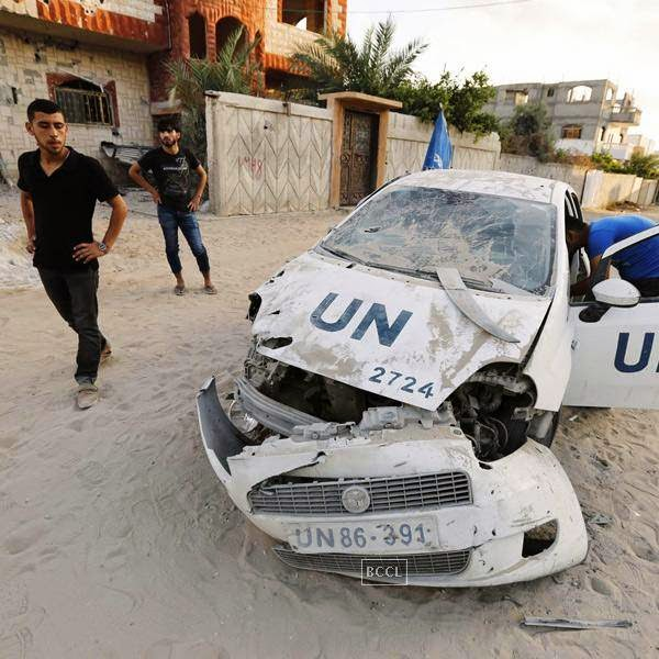 A destroyed UN vehicle is seen in Beit Lahia in the northern Gaza Strip on July 29, 2014 following Israeli military strikes. The Palestinians said factions were ready for new Gaza truce and Washington said Israel had sought help today in calming a 22-day conflict that has killed nearly 1,200 in the enclave.