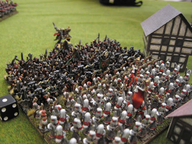 The Chaos Warriors charge the Archers and Sword Masters