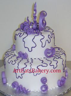 Purple lace and sugar sculptures two tier custom wedding cake design with sugar pearls