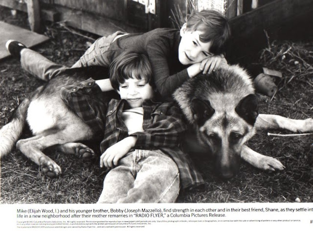 Elijah Wood and Joseph Mazzello and a dog