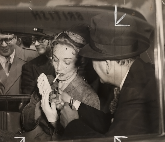 Noël Coward lighting Marlene Dietrich's cigarette, taken in June 1954 by G Warner for the Daily Herald.