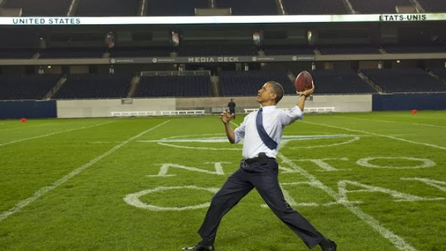 Obama tosses the pigskin despite cautionary words