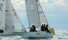J/24 crew sailing off Taranto, Italy