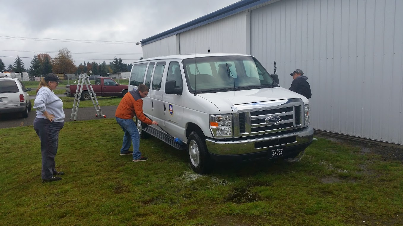 Maj Cox supervises C/SSgt Z'berg abd Mr Wheeler as they scrub the South Sound Van.