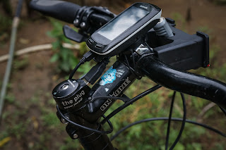The Plug II+ USB Charger by Tout Terrain tucked away inside the top the steer tube; cumbersome to install, but easy to use