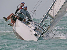 J/80 sailing upwind off Hong Kong, China