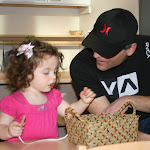Bead stringing is a fun activity toddlers are drawn to at LePort's Parent & Child Montessori program where dads get to see how capable their girls can be!