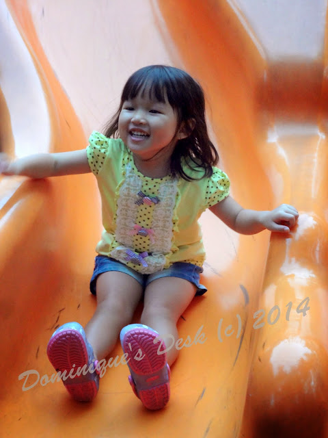 Tiger girl on a slide