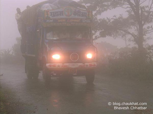 On the cloudy road on way to Bhimashankar, a truck with full beam head lamps turned on, is trying to find its way.
