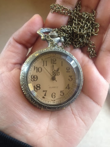 Bronze-clad rose coloured watch pendant