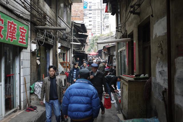 an alley full of people walking