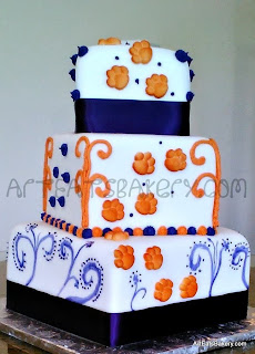Three tier square white fondant wedding cake with orange and purple designs and sugar Clemson University tiger paws